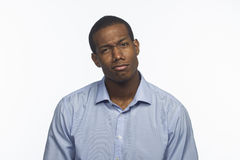 Young African American gives disapproving look, horizontal Royalty Free Stock Image