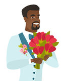 Young african-american groom with bridal bouquet. Stock Photo