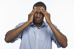 Young African American with headache, horizontal Royalty Free Stock Image