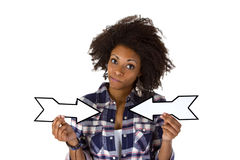 Young african american holding blank arrows Stock Photo