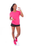 Young african american jogger woman drinking water, isolated on Stock Photography