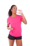 Young african american jogger woman drinking water, isolated on Royalty Free Stock Photography
