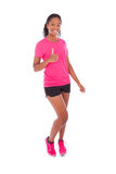 Young african american jogger woman making thumbs up gesture, is Royalty Free Stock Photos