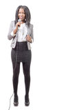 Young African american journalist with a microphone Royalty Free Stock Photography