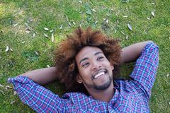 Young african american male lying in grass Stock Photo