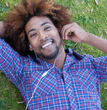 Young african american male lying in grass Royalty Free Stock Photo