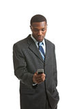 Young African American Male Model TXTing Isolated Royalty Free Stock Images