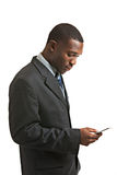 Young African American Male Model TXTing Isolated Stock Photo