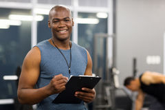 Young african american male personal trainer Stock Image