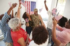 Young African American  male soldier returning home to his cheering family, elevated view. Young black male soldier returning home to his cheering family stock photography