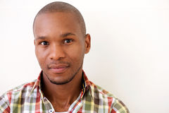 Young african american man against white background Stock Photos
