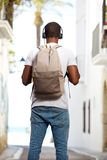 Young african american man with bag standing in street Stock Image