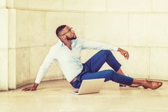 Young African American Man with beard working on laptop computer Royalty Free Stock Images