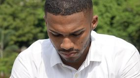 Bearded Male And Sadness. A young african american man Stock Image