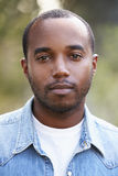 Young African American man in denim shirt, vertical portrait Stock Images