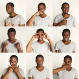 Set of black man`s portraits with different emotions royalty free stock images