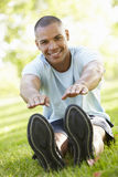 Young African American Man Exercising In Park Stock Photography