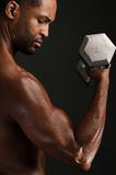 Young African American Man Flexing Biceps Royalty Free Stock Photo