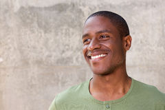 Young african american man on gray background smiling Royalty Free Stock Images