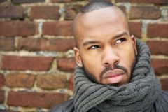 Young african american man with gray scarf looking up Stock Image