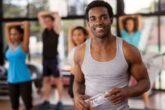Young African-American man in a gym. Young African-American men in a gym preparing to exercise Royalty Free Stock Photos