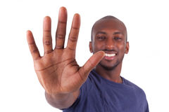 Young African American man his hands palm Royalty Free Stock Image