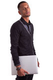 Young african american man holding a laptop Stock Photos