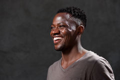 Young african american man laughing and looking away Stock Photography