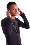 Young african american man listening to music Stock Photo