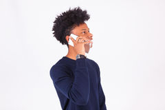 Young African American man making a phone call on her smartphone Royalty Free Stock Photo