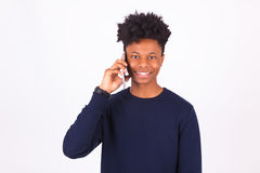 Young African American man making a phone call on her smartphone Stock Images