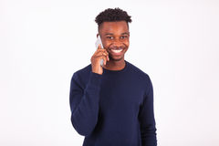 Young African American man making a phone call on her smartphone Stock Photography