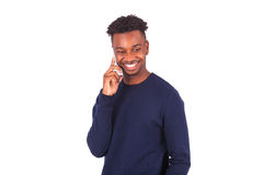 Young African American man making a phone call on her smartphone Stock Photo