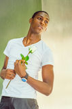 Young African American Man Missing You with white rose in New Yo Stock Photo