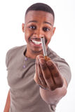 Young african american man offering a cigarette Stock Photo