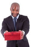 Young African American man offering a gift Royalty Free Stock Photo
