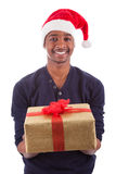 Young African American man offering a gift Royalty Free Stock Photos