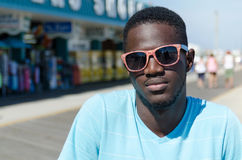 Young African American man outdoors portrait. Young African American man wearing sunglasses outdoors portrait Stock Photos