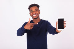 Young African American man pointing his  smartphone screen - Bla Stock Photos