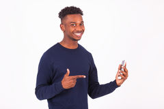 Young African American man pointing his  smartphone screen - Bla Stock Photography