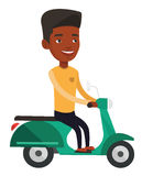 Young african-american man riding scooter. Royalty Free Stock Photo