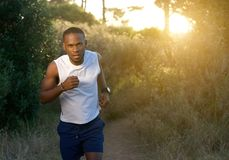 Young african american man running outdoors Stock Photo