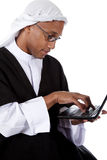 Young African American man, sheikh, laptop Stock Image