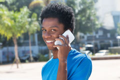 Young african american man speaking at mobile phone Royalty Free Stock Photo