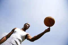 Young African American man spinning a basketball on his finger Royalty Free Stock Photos