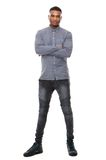 Young african american man standing with arms crossed. Full length portrait of a young african american man standing with arms crossed on isolated white Royalty Free Stock Photos