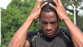 Stressed African Male Athlete. A young African American man stock video
