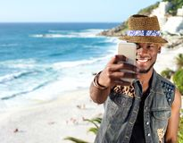 Young african american man taking selfie at the beach Royalty Free Stock Image