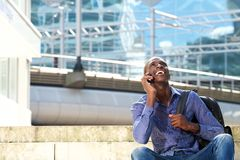 Young african american man talking on cell phone and smiling Stock Photos