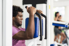 Young african american man training in fitness gym